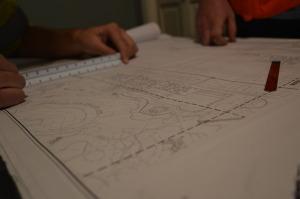 surveyors reviewing Austin surrounding Area Survey